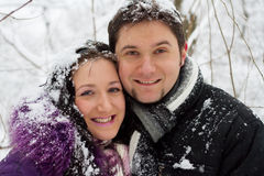 Young happy couple in winter park Stock Photography