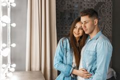 Free Young Happy Couple With A Smile In Jeans Clothes Near A Vintage Stock Photography - 124209702