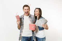Young happy couple, woman and man watching movie film on date holding bucket of popcorn plastic cup of soda or cola and. Bundle of dollars cash money isolated stock photos