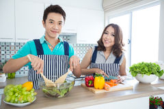 Couples in kitchen Stock Photo