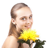Young happy cute woman with yellow flower Stock Photo