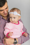 Young happy Dad keeps daughter. In her arms Royalty Free Stock Images