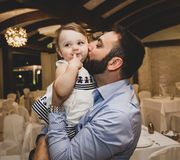 Dad kissing daughter stock photos