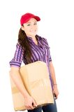 Young happy delivery woman holding package Royalty Free Stock Image