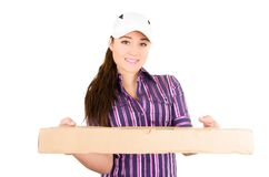 Young happy delivery woman holding package Stock Photography