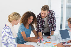 Young happy design team brainstorming together Royalty Free Stock Photo