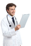 Young happy doctor man holding a medical history Royalty Free Stock Photo
