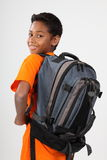 Young happy ethnic schoolboy 11 wearing rucksack Royalty Free Stock Images