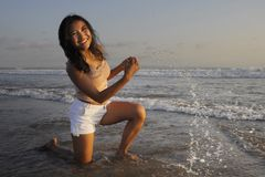 Young happy and excited Asian woman having fun enjoying playful and free at sunset beach in tourism vacation. And summer holiday trip concept on a beautiful sea Royalty Free Stock Photography