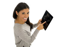 Young happy and excited hispanic woman holding digital tablet pad smiling isolated on white Royalty Free Stock Photos