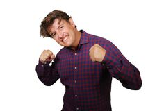 Young happy and excited man smiling cheerful celebrating achievement or business project success gesturing joyful and charming. Isolated on white background in stock image
