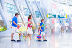 Young happy family at the airport Stock Photo