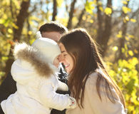 Young happy family in autumn park Stock Photos