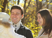 Young happy family in autumn park Stock Photography