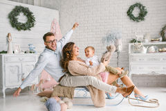 Young happy family with baby in christmas decor studio Stock Photography