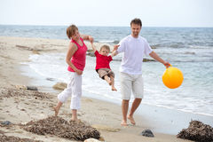 Young happy family on the beach Stock Photography