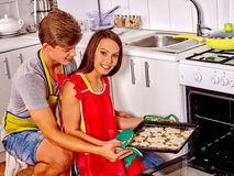Young happy family cooking at kitchen Royalty Free Stock Images