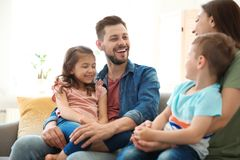 Young happy family with children at home. Young happy family with cute children at home royalty free stock image