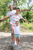 Young happy family enjoying their holidays Stock Photography