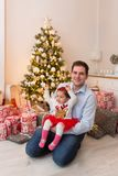 Young happy family in front of a Christmas tree stock photography