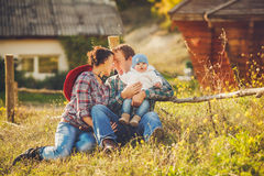 Young happy family having fun at countryside Stock Image