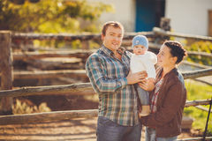 Young happy family having fun at countryside Royalty Free Stock Photos