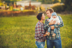Young happy family having fun at countryside Stock Images
