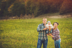 Young happy family having fun at countryside Royalty Free Stock Photography