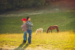 Young happy family having fun at countryside Stock Photos