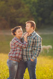 Young happy family having fun at countryside Stock Photography