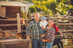 Young happy family having fun at countryside. Portrait of a Young happy family having fun at countryside outdoors. Summertime Stock Photography