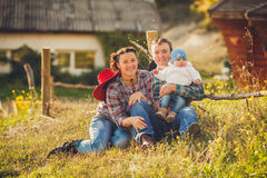 Young happy family having fun at countryside. Portrait of a Young happy family having fun at countryside outdoors. Summertime Royalty Free Stock Photo