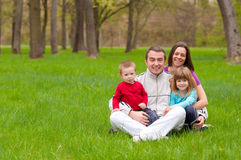 Young happy family having fun in the nature Royalty Free Stock Image