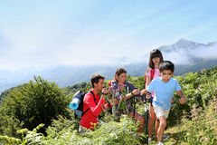 Young happy family hiking in natireal landscape Royalty Free Stock Photos