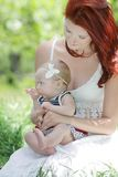 Young happy family on nature Royalty Free Stock Photography