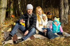 Young happy family in nature Stock Photography