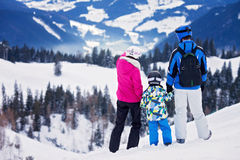 Young happy family with one child, skiing in the mountains Royalty Free Stock Images