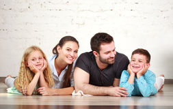 Young happy family parents and two children home studio stock photo