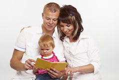 Young happy family reading Stock Photography