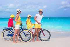 Young happy family riding bicycles on tropical Stock Photography