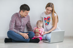 Young happy family running on a laptop Stock Photo
