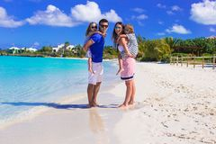 Young happy family during summer vacation Stock Image