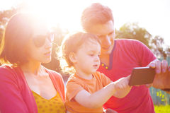 Young and happy family taking a selfie. Royalty Free Stock Image
