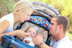 Young Happy Family Of Three With Baby Stock Images