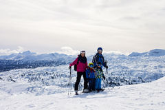 Young happy family with two childrens, boy brothers, skiing in A Royalty Free Stock Photos