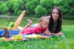 Young happy family of two picnicking in the park Stock Photography