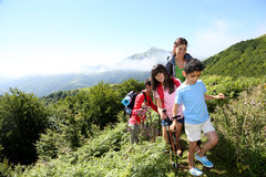 Young happy family walking in mountains Stock Photos