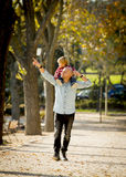 Young happy father carrying little son on shoulders having fun royalty free stock photography