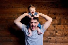 Young happy father and child on shoulders royalty free stock photo