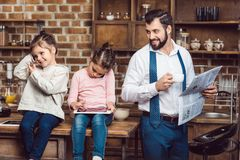young happy father and daughters spending time on kitchen royalty free stock photography